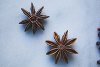 Overhead view of star anises on marble