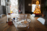 Close-up of flour in bowl with syrup on table at home