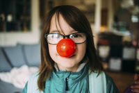 Portrait of girl wearing clown's nose