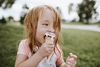 Close-up of girl eating ice cream in park