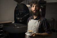 Portrait of man with coffee in cafe