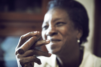 Close-up of woman holding cigar
