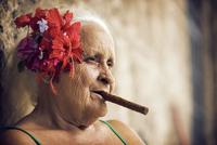 Close-up of senior woman smoking cigar