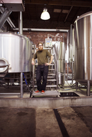 Portrait of confident brewer standing at brewery
