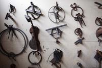 Various metallic designs hanging on wall