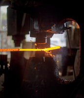 Machinery working on molten metal at factory