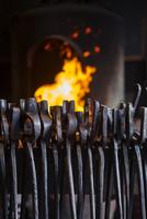 Various metallic tongs in factory