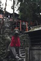 Fox statute at fushimi inari shrine