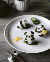 High angle view of panda shaped onigiri on plate 11100055560| 写真素材・ストックフォト・画像・イラスト素材|アマナイメージズ