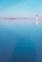 Distant view of woman standing in lake at Bonneville Salt Flats