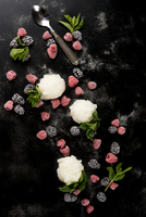 Overhead view of sorbet with berry fruits on table