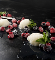 High angle view of sorbet with berry fruits on table