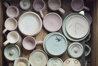 Overhead view of various ceramics on table in workshop