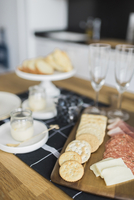 High angle view of food with champagne flutes on table at home