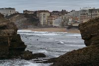 View of beach against residential buildings
