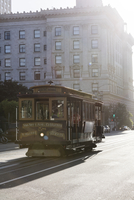 Tramway on city street during sunny day