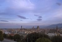 Distance view of Palazzo Vecchio and Duomo Santa Maria Del Fiore in city against sky