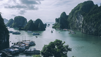 High angle view of boats moored at Halong bay by mountains against sky