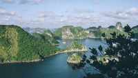 High angle view of Halong bay by mountains against sky