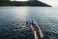 Rear view of man diving into sea