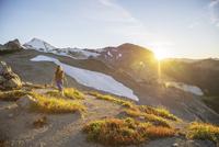 Female hiker hiking on mountain against sky