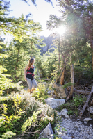 Female hiker hiking in forest at North Cascades National Park