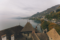 High angle view of Chillon Castle and Lake Geneva against cloudy sky