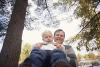 Low angle portrait of father and son enjoying at park