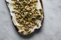 High angle view of toasted bread with pumpkin seeds on table 11100061528| 写真素材・ストックフォト・画像・イラスト素材|アマナイメージズ
