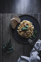 Overhead view of creamy beef and dried tomato fettuccine served with bread in plate on table 11100062090| 写真素材・ストックフォト・画像・イラスト素材|アマナイメージズ