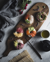 Overhead view of sushi donuts on wooden plate 11100062126| 写真素材・ストックフォト・画像・イラスト素材|アマナイメージズ