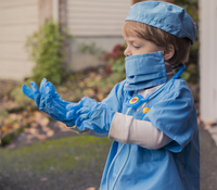 Boy in doctor costume wearing gloves while standing in yard 11100062881| 写真素材・ストックフォト・画像・イラスト素材|アマナイメージズ