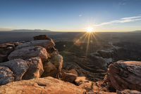 Rock formations at Canyonlands National Park against bright sky