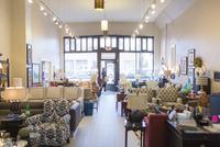 Female customer entering furniture store 11100063289| 写真素材・ストックフォト・画像・イラスト素材|アマナイメージズ