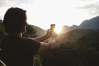 Man talking selfie while standing against mountains