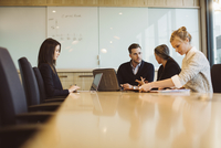 Business people discussing in meeting at board room 11100064208| 写真素材・ストックフォト・画像・イラスト素材|アマナイメージズ