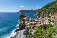 Colorful houses on cliffs with beach, overlooking Vernazza