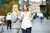 Young women eating ice cream together.