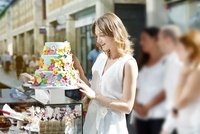 Young woman looking at decorated cake.