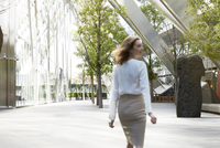 Young woman walking in business park.