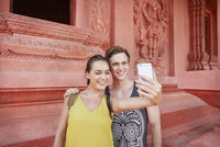 Young couple taking selfie at temple