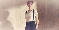 Young woman wearing suspenders with shadow