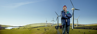 Mature man in front of wind farm