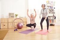 Senior women doing yoga together
