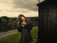 Mature woman lighting cigarette in United Kingdom