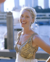Mid adult woman on pier wearing sequined jacket
