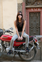 Young woman sitting on motorcycle
