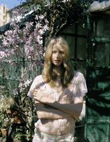 Blond haired young woman in garden
