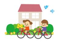 自転車の子どもと家