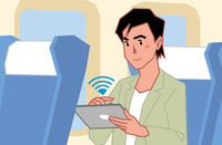 電車内でタブレットを使う若い男性 60008000687| 写真素材・ストックフォト・画像・イラスト素材|アマナイメージズ